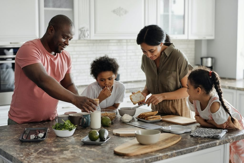 family in the kitchen cooking
