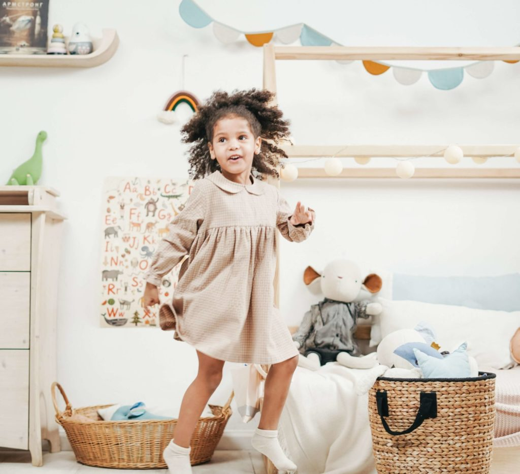 kid playing in her bedroom